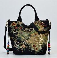 bolsa de yunnan al por mayor-2019 nuevo bolso bordado de viento nacional de Yunnan bordado de lona paquete de hombro diagonal portátil para mujer madre de mediana edad
