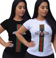 siyah beyaz çizgili tişört kadın toptan satış-Kadın t-shirt klasik Siyah ve beyaz arı Çizgili baskı Kısa kollu moda tatlı Yarım kollu fabrika toptan