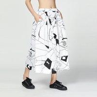 falda abstracta al por mayor-LANMREM 2019 Summer Bottoms para mujeres Personalidad Abstract Space Printing Falda de medio cuerpo Loose Casual All-match Bottoms YH381
