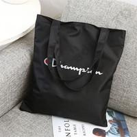 modaya uygun tuval çantaları toptan satış-Kadın Şampiyonlar Eğlence Tuval Çanta Mektup Baskı Bir Omuz Çantası Alışveriş Seyahat Büyük Kapasiteli Saklama Torbaları Trendy Bayanlar Tote C3191
