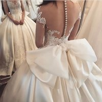 Wholesale big white bride dress resale online - Princess Lace Ball Gown Wedding Dresses Bride Gowns Vestidos De Noiva Backless Custom Made with Big Bow Sheer Neck
