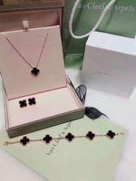 conjuntos de joyas pulseras al por mayor-Diseño simple de cuatro hojas del trébol de la joyería de la pulsera de plata esterlina con collar y pendientes Declaración de alta calidad collar de suministro
