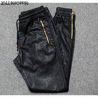 pantalon de jogging en faux cuir pour homme achat en gros de-Les hommes Joggers Faux Pantalon en cuir Jogger Hip Hop PU glissière latérale en cuir Sarouel ouverture à glissière jambe Pantalon taille coulissée CJ191128