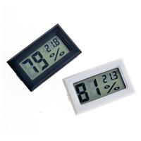 11 metros al por mayor-2017 nuevo negro / blanco FY-11 Mini Digital LCD Termómetro de ambiente Higrómetro Medidor de temperatura de humedad En la nevera de la habitación