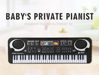 mikrofone kinder großhandel-neue 2019 Kinder E-Piano mit Mikrofon Klavier Multifunktions 61 Schlüssel 6106 Baby Studio Musik Spielzeug Amazon
