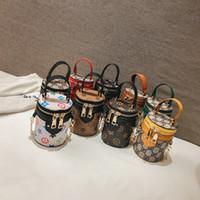 bebek çantası modası toptan satış-Çocuklar Tasarımcı Çanta Yeni Bebek Kız Mini Prenses Pruses Moda Klasik Baskılı Kova Tasarımcı Çocuklar Çapraz vücut Çanta Doğum Günü hediyeler