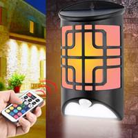patio de la villa al por mayor-LED Solar RGB Sensor de luz de pared Montion LED colorido Luz de llama Lámpara de campana de puerta IP65 Impermeable para patio al aire libre patio villa paisaje