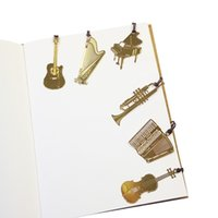 marca livros venda por atacado-50 Pçs / lote Bonito Kawaii Dourado Marcadores de Música De Metal Piano Guitarra Desenhos de Trombeta Livro Marcas Presentes Y19062803