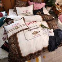juegos de cama de impresión animal marrón al por mayor-Leopardo de Brown Cubierta de impresión Cama absoluto de los sistemas de algodón bordado sistemas del lecho La 4/5/6/7 Piezas de cama Textiles para el Hogar