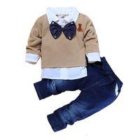 oso arco bebé al por mayor-Niños bebés Traje de mezclilla Traje de niños Pantalones Niños Diseñador Marca Ropa Niños Traje de manga larga Arco Oso Bordado Solapa 41
