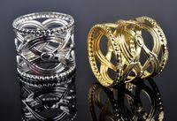 metal redondo chino al por mayor-Venta al por mayor de fábrica 100 unids Directsale redondo tallado estilo chino anillo de servilleta patrón hueco redondo oro plata titulares