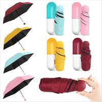 paraguas luces solares al por mayor-Cápsula de bolsillo plegada Paraguas soleado Luz creativa Protección solar y paraguas para la lluvia Paraguas pequeño de cinco pliegues tipos coloridos LJJQ104