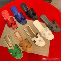гостиничные тапочки оптовых-Классические тапочки Летние женские пляжные туфли Дизайнерские кожаные туфли на плоской подошве Hotel Банные тапочки Cartoon Big Head Тапочки Большой размер 35-42