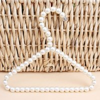 Wholesale clothes hangers pearls for sale - Group buy Pearl Coat Hanger Dogs Clothes Stand Coarse Wire Clothing Rack Pet Supplies Small And Exquisite White hw C1