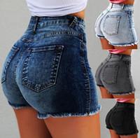 pantalones vaqueros pantalones mujeres calientes al por mayor-2019 mujeres del verano Jeans de cintura alta diseñador de moda borla agujero pantalones cortos Jeans mujer pantalones pitillo caliente