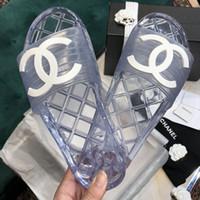 rahat düz bayanlar sandalet toptan satış-Son tasarımcı çevirme kadınlar Parlak Şeffaf kauçuk terlik En kaliteli Yaz Bayanlar için Rahat PVC daireler sandalet boyutu 35-41