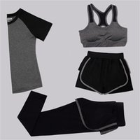 ingrosso black female yoga pants-Donna 4 pezzi Yoga Set Bra + T-shirt + Pantaloncini + Pantaloni Nero / Grigio Patchwork Quick Dry Ragazze Sportswear Palestra Running Outwear femminile # 147368
