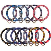 pulseiras de ferro venda por atacado-Pulseiras de couro Envoltório Chaveiros Tendência Da Moda Pulseiras Chaveiro PU Liga de Ferro Borlas Pingente Pulseiras Chaveiro Lady Popular 7cp N1