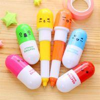 Wholesale pills shaped pen resale online - Cute Pill Shape Retractable Ballpoint Pen Kawaii pill shape novelty ballpen Lovely learning stationery Kids toy gifts