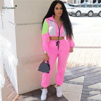 grüne lycrahose großhandel-Frauen streetwear 2 stück hosen set wasserdichte langarm patchwork jacke rosa grün lila passenden sweatsuit club trainingsanzüge