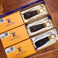geführtes keychainkarikatur groihandel-Designer-Mode-Accessoires DRAGONNE Schlüsselbund Hängende Autoschlüssel Accessoires Lederschnalle Vergoldetes Kupfermetall-Accessoires