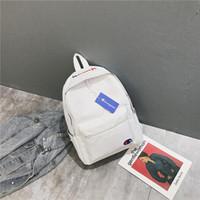 mochilas para hombre más calientes al por mayor-Nueva marca de la llegada Mochila Venta caliente Bolsas de viaje al aire libre Hombres y mujeres Estudiantes Moda Bolsos