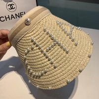 Wholesale wide beach summer hat for sale - Group buy hat caps sun Travel profit hat woven pearl fashion ladies flat top wide brimmed bucket hat outdoor sports sun visor femmes caps CHAN