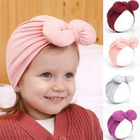 Wholesale girls cap design resale online - Newborn Baby Winter Hats Design Solid Bow Fetal Cap Baby Kids Caps Infant Girl Caps Child Turban Hat