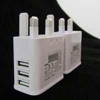 carregador de parede plugue para ipad venda por atacado-3 usb porta reino unido gb 3 pin plug adaptador de energia carregador de parede de viagem em casa para samsung galaxy s6 s7 borda nota 4 5 para iphone 5 6 7 para ipad