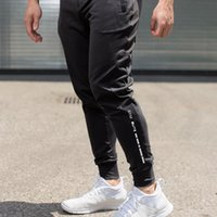 Wholesale black leggings feet for sale - Group buy New Mens Pants Letters Printing Little feet Slim Fit Fitness Pure Color Outdoor Training Run pants