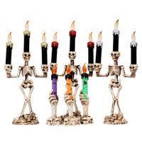 flammenlose kerzen orange großhandel-Halloween Candle Light Flameless Elektronische Hochzeitskerzen Halloween Skeleton Ghost Handkerze Dekorative Led Candle Light Holiday Decor