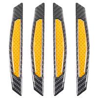 guarnição preta da borda venda por atacado-Fibra 4pcs 3D amarelo reflexivo adesivos Preto real do carbono Tiras Car porta lateral Borda Bumper Protecção Anti-riscos Guards guarnição