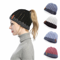 Wholesale stylish women hats for sale - Group buy New Arrival Winter Hollow Out Warm Ponytail Beanie Hat Women Messy Bun Cap Winter Warm Knitted Stylish