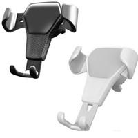 suportes de telefone montados no ventilador venda por atacado-Suporte Do Telefone Do carro Para O Telefone No Carro Suporte de Montagem de Suporte de Ventilação de Ar Não Magnético Suporte Do Telefone Móvel Gravidade Universal Suporte Celular Por Smartphone