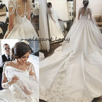 Wholesale feather basque wedding dress resale online - Round Neck Long Sleeves Chapel Train Wedding Dresses Luxury Lace Applique Middle East Arabic Princess Church Royal Wedding Gown Veil