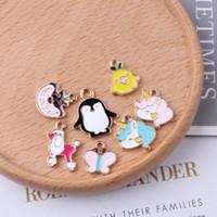 kc schmuck großhandel-10 stücke Metall Diy emaille Tier haustiere mit cartoon pinguin charme KC gold legierung kleine armband anhänger Koreanische schmuck zubehör