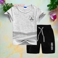jungen designer-shorts großhandel-Neue Designer Marke Kinder Jungen Mädchen Sportbekleidung Kinder Kurze Ärmel Anzug Kinder Set Sommerkleidung 2-7 T