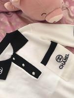 chemise col tricoté achat en gros de-2019 été nouvelle mode des femmes de la mode à manches courtes bloc de couleur lettre broderie rabattre le col élégant soie pull en tricot de chemise en tête