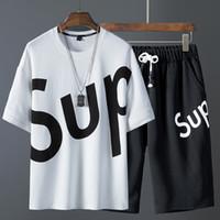 camisetas oxford al por mayor-Traje de chándal y monos de mujer de NDYPmens diseñador Combinación de nuevos pantalones cortos y mangas cortas para hombre camisetas de diseñador camisas polo para hombres