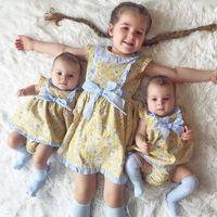 robes de fille de fleur de coton jaune achat en gros de-H978 # fille imprimé coton robe de coton stryle postroral fraîche fleur jaune bébé mouche manches papillon noeud robes