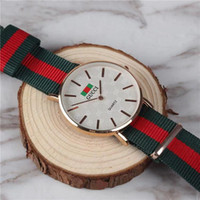 тонкие женские модные часы оптовых-Люксовый бренд мужчины и женщины мода часы высокое качество бизнес мужские нейлоновые часы дамы повседневная простой ультра-тонкий пара кварцевые часы