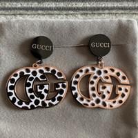 leopardo de oro rosa al por mayor-Diseño de lujo de alta calidad punk exagerado Pendientes de gota de titanio Leopard Joyería de las mujeres Shinning negro rosa Carta de Oro cuelga