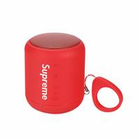 teléfonos celulares de marca bluetooth al por mayor-Diseñador SuP Teléfono celular Altavoz Marca Bluetooth Altavoz Moda Subwoofer Altavoz Bluetooth inalámbrico Micrófono de música con negro y rojo