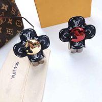 Wholesale charm flower keychain for sale - Group buy Designer Luxury Keychain Cute Flower Steel Robot Leather Accessory Car Keychains Women Bag Charm Pendant Birthday Gift Key Holder