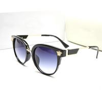 gafas de color teñido al por mayor-Nuevo Ojo de gato Mujer Gafas de sol Tintado Lente de color Hombres Lujo al aire libre Vintage Gafas de sol Gafas femeninas Gafas de sol azules Diseñador de la marca