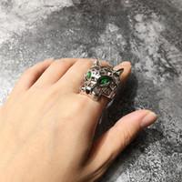 placa de olho de tigre de anel venda por atacado-Venda quente Requintado moda cobre banhado a ouro oco olho verde Cabeça de tigre Leopard cabeça anéis de designer de moda jóias anel para mulheres e homens