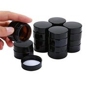 ko großhandel-5g 10g bereift klare klare bernsteinglas glas hautpflegecreme flaschen behälter mit schwarz silber gold deckel und innenkissen