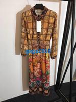 blumendruck bleistift röcke großhandel-Frauen Mädchen Hemd Kleid Plaid Blumendruck Revers Hals Langarm A-Linie Trompete Vintage Bleistift Midi Röcke High-End-Mode Luxus Kleider