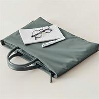 Wholesale korean laptop bags resale online - Men Women Briefcases Ladies Handbag Korean Simple Fashion Briefcase Unisex Inch Laptop Bag Oxford Cloth Bag Soild Schoolbag