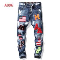 ingrosso pantaloni jeans coreani per gli uomini-Wholesale-29-38 uomini vestiti firmati denim pantaloni del tralicco della tuta coreano roccia splash-ink moto tratto afflitto strappato uomini magri foro dei jeans